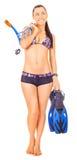 Woman standing wearing snorkel standing. isolated. Woman isolated standing wearing snorkel holding snorkeling fins standing isolated on white royalty free stock photos