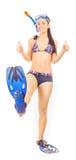 Woman standing wearing snorkel standing. isolated. Woman isolated standing wearing snorkel holding snorkeling fins standing isolated on white Stock Image