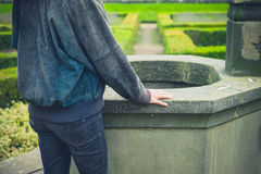 Woman standing by well Royalty Free Stock Photography