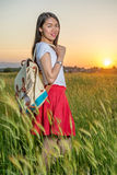Woman standing in a wheat field at sunset Royalty Free Stock Images