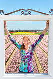 Woman standing in window in front of pink flowers field. Woman standing in window in front of pink hyacinths flowers field in Holland stock images