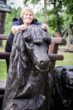 Woman standing on a wooden horse. Stock Photos