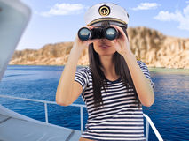 Woman standing on the yacht Royalty Free Stock Image