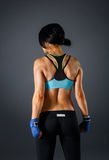 Woman stands from the back in fitness suit Royalty Free Stock Photos