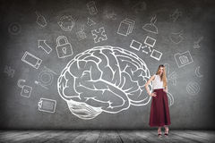 Woman stands beside big drawn brain royalty free stock photos