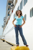 Woman stands on bitt near board of multideck ship Royalty Free Stock Photography
