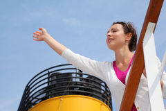 Woman stands on board of large ship Stock Photography