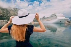 Woman stands on cruise liner background. Young woman in hat stands on cruise liner background, rear view royalty free stock photos