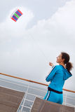 Woman stands on cruise liner deck Royalty Free Stock Photo