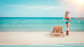 A woman stands facing the sea. Stock Images