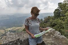 Woman stands forward to San Marino landscape with amazing view Stock Images