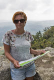 Woman stands forward to San Marino landscape with amazing view Royalty Free Stock Images
