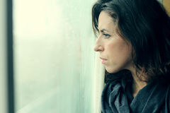 Woman stands in front of the window Royalty Free Stock Photo