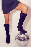 Woman stands on glitterball Stock Photography