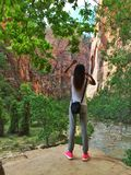 Woman stands inside the National Zion Park,Utah Stock Photo