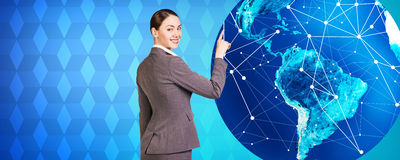 Woman stands near big earth Royalty Free Stock Images