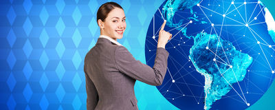 Woman stands near big earth Royalty Free Stock Image