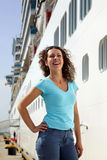 Woman stands near board of multideck ship Stock Photos
