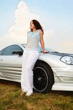 Woman stands near sport car Royalty Free Stock Photo