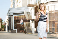 Woman stands near stores. A young woman stands near stores Stock Photo