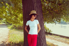Woman stands near a tree Royalty Free Stock Images