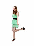 Woman stands on one leg Stock Photo