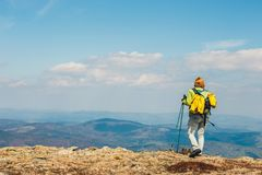 Woman stands on the path and looks at the tops stock images