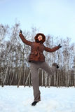 Woman stands on to snow and gravitate skyward Royalty Free Stock Photography
