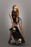 Woman standting with DJ Mixer stock photography