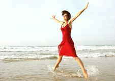 Woman star jumping Stock Images