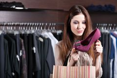 Woman stares at excellent fuchsia shoes royalty free stock image