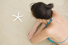Woman with starfish Royalty Free Stock Images