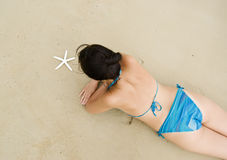 Woman with starfish Stock Photos