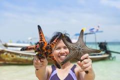 Woman and Starfish Royalty Free Stock Photo