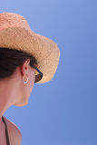 Woman staring. Woman with straw hat and sun glasses Stock Photo