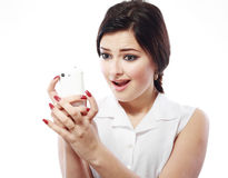 Woman staring. Shocked woman staring at her mobile phone in disbelief royalty free stock images