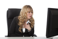 Woman staring in consternation at her monitor Stock Photo
