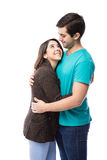 Woman staring at her boyfriend. Cute young women holding her boyfriend and looking at him against a white background Royalty Free Stock Image