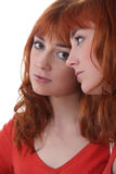 Woman staring at her reflection Royalty Free Stock Image