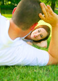 Woman Staring At Man. Caucasian woman smile to her lover, taken through her husband hand Royalty Free Stock Image