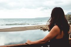 Woman staring at the sea Stock Photography