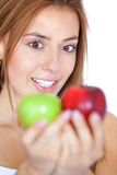 Woman staring at two apples Stock Image