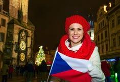 Woman on Staromestske namesti in Prague showing Czech flag Royalty Free Stock Photography