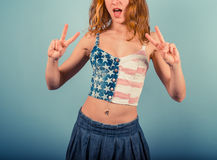 Woman in stars and stripes showing peace sign Stock Photography