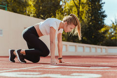 Woman in start position for run Royalty Free Stock Photography
