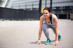 Woman at start position to run Stock Photo