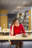 Woman start reading fat book with glasses Stock Photo