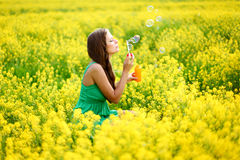 Woman start soap bubbles Royalty Free Stock Photography