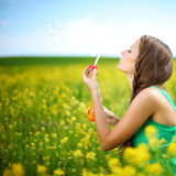 Woman start soap bubbles Royalty Free Stock Photo