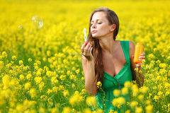 Woman start soap bubbles Stock Photos